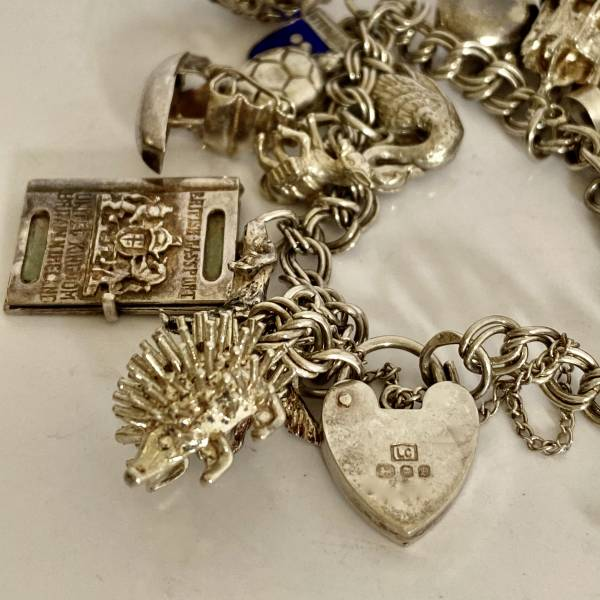 Vintage silver charm bracelet, Antique silver, jewellery, collectables & more. Greystones Antiques, Co. Wicklow, Ireland. 20km south of Dublin.
