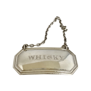 silver drink's label, Antique silver, jewellery, collectables & more. Greystones Antiques, Co. Wicklow, Ireland. 20km south of Dublin.